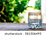glass of water on old wooden... | Shutterstock . vector #581506495