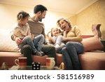 happy family at home spending... | Shutterstock . vector #581516989