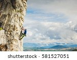 young man climbing natural... | Shutterstock . vector #581527051