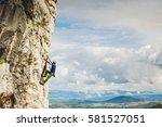 young man climbing natural... | Shutterstock . vector #581527051