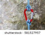 red carabiner with climbing... | Shutterstock . vector #581527957