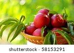 Mature peachs on basket. - stock photo