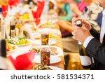 blurred background  a man opens ... | Shutterstock . vector #581534371