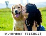 Pretty Girl Kissing A Dog On A...