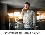 bearded man with laptop phone | Shutterstock . vector #581571724