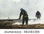 firefighters battle a wildfire... | Shutterstock . vector #581581585