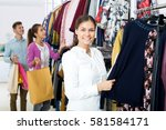 young woman customers chooses... | Shutterstock . vector #581584171