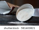 xanthan gum spilling from a... | Shutterstock . vector #581603821