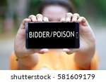 Small photo of Smart Phone with word BIDDER/POISON