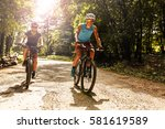 Two Mountain Bikers Riding Bik...
