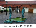 Small photo of PRAGUE, CZECH REPUBLIC - SEPTEMBER 12, 2012. The Piss scultpture by Czech artist David Cerny with two animatronic figures piddling in a puddle in front of Franz Kafka Museum in Prague.