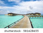 wooden water bungalows  maldives | Shutterstock . vector #581628655