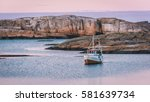 lonely boat at the sunset on a... | Shutterstock . vector #581639734
