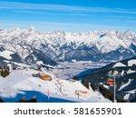 mountain ski resort on sunny... | Shutterstock . vector #581655901