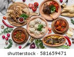 a lot of food on the wooden... | Shutterstock . vector #581659471
