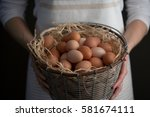 Woman Holding Wire Basket Of...