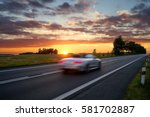 speeding motion blur white car... | Shutterstock . vector #581702887