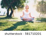 yoga at park. senior woman in... | Shutterstock . vector #581710201