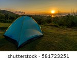 tourist tent in camp among... | Shutterstock . vector #581723251