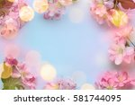 spring flower with lights copy... | Shutterstock . vector #581744095
