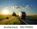 arriving red truck on the road... | Shutterstock . vector #581749081
