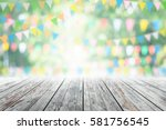 empty wooden table with party... | Shutterstock . vector #581756545