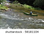 Canoeist in calm water - stock photo