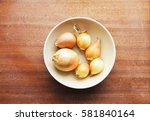 six yellow onion heads in a...