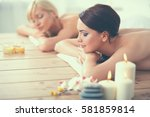 two young beautiful women... | Shutterstock . vector #581859814