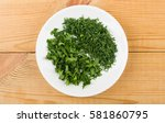 chopped parsley and dill in... | Shutterstock . vector #581860795