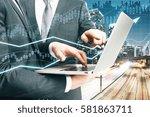 two businessmen using laptop on ... | Shutterstock . vector #581863711