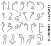 hand drawn arrows in gray.... | Shutterstock .eps vector #581893855
