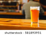 nonic pint glass with pale ale... | Shutterstock . vector #581893951