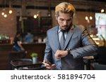 businessman talking on phone...   Shutterstock . vector #581894704
