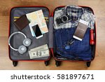 packed suitcase with travel... | Shutterstock . vector #581897671