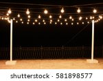 garlands of lamps on a wooden... | Shutterstock . vector #581898577