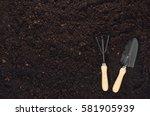 gardening tools on fertile soil ... | Shutterstock . vector #581905939
