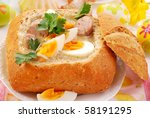 easter white borscht with eggs and sausage in bread bowl - stock photo