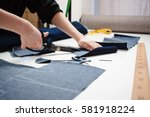 Hands Of Seamstress Cutting A...