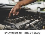 man with checking car engine. | Shutterstock . vector #581941609
