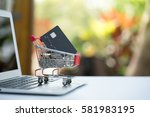 small shopping cart contains... | Shutterstock . vector #581983195