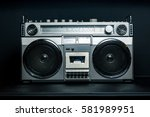 vintage radio boombox on dark... | Shutterstock . vector #581989951