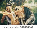 group of young people having... | Shutterstock . vector #582010669