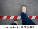 one walking across red and... | Shutterstock . vector #582024487