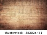 brown scratched wooden cutting... | Shutterstock . vector #582026461