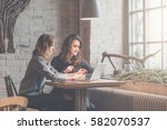 one on one meeting.two young... | Shutterstock . vector #582070537