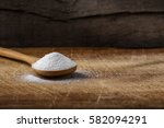 one bamboo spoon filled with... | Shutterstock . vector #582094291