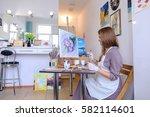 charming young woman artist...   Shutterstock . vector #582114601