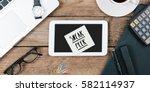 sneak peek note on office desk... | Shutterstock . vector #582114937
