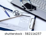 stethoscope with clipboard and... | Shutterstock . vector #582116257